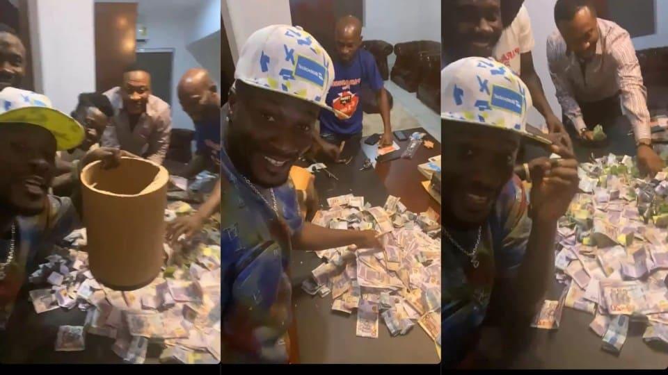 (+Video) Asamoah Gyan displays huge money he made from 'susu box' savings in just 6 months